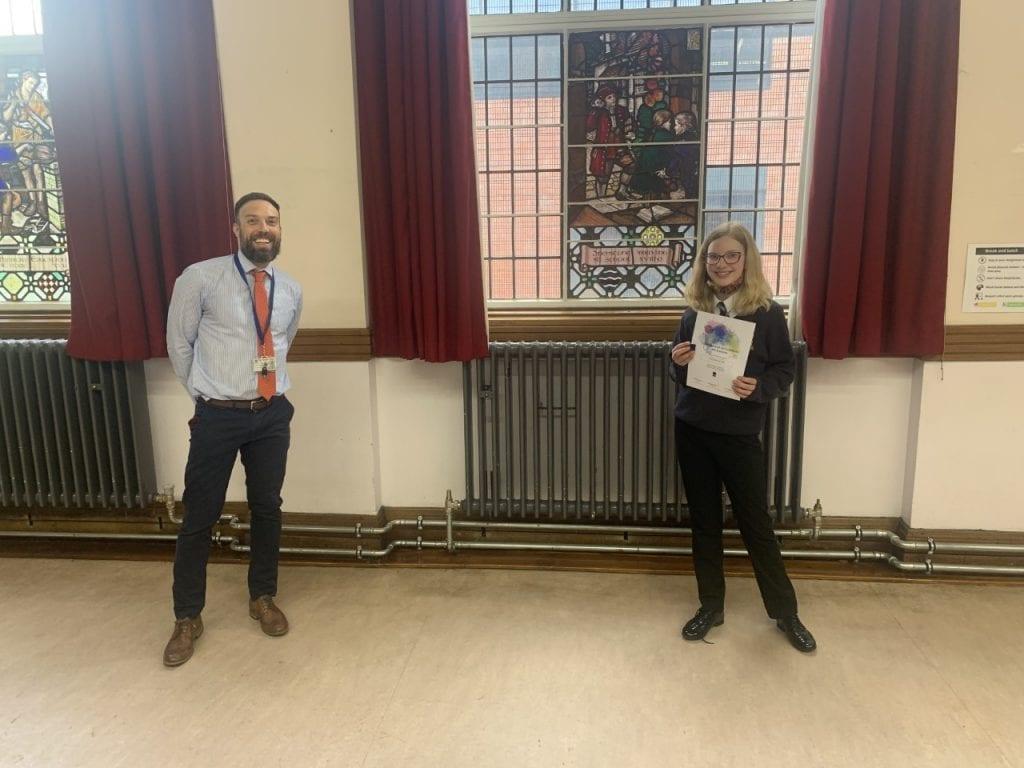 Student receiving arts award